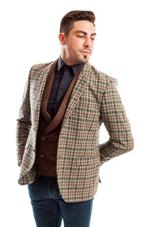 Elegant male model wearing checkered suit jacket and retro vest photo