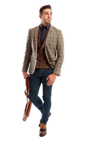 male fashion: Casual and retro fashionable business man wearing plaid suit jacket and jeans Stock Photo
