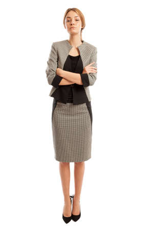 confident consultant: Young and confident business consultant standing with her arms crossed Stock Photo