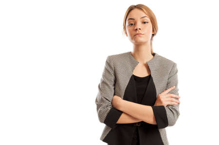 Confident business woman with arms crosses and head up posing on white background photo