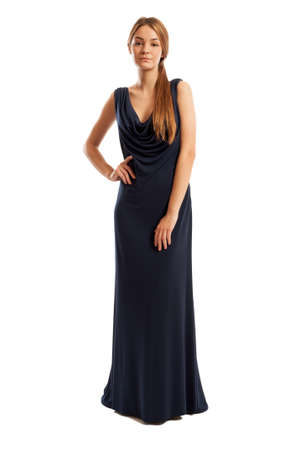Beautiful female model wearing a long navy blue dress and posing photo