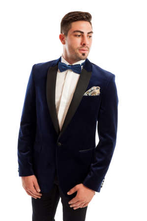 brunets: Handsome and elegant male model wearing blue suit, bow tie and handkerchief Stock Photo