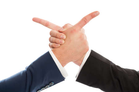 Business men shaking hands and pointing at each other using fingers photo