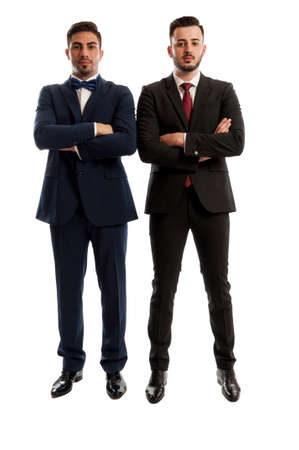 men standing: Two confident business men standing and crossing the arms Stock Photo