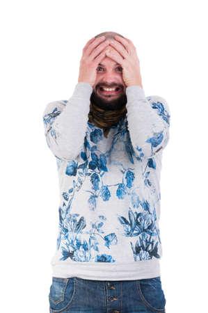 desperation: Man making a crazy desperation face by grabbing his head