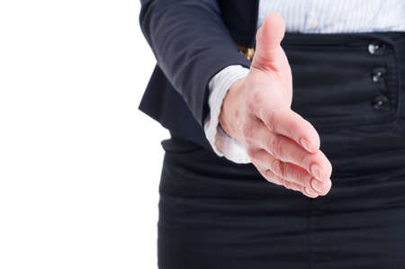 Closeup of business woman hand shake gesture with white copy space on the left photo