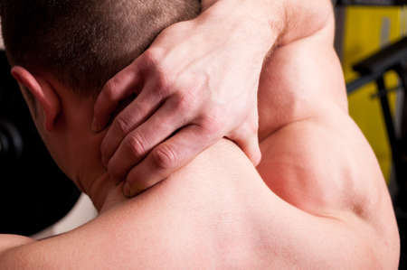 muscular body: Back of the neck neck pain concept with a muscle man