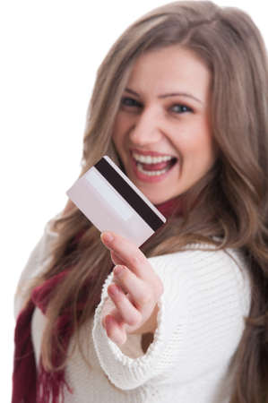 Young woman showing a credit, debit or shopping card  with focus on the hand photo
