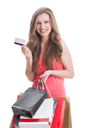Shopping lady using credit or debit card to buy things online photo