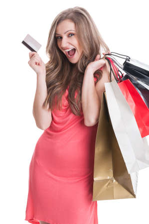 Enthusiastic shopping lady using credit or debit card for online stores photo