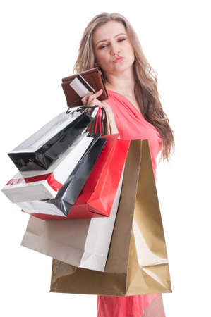 Satisfied shopping lady holding bags, card and wallet on white background photo