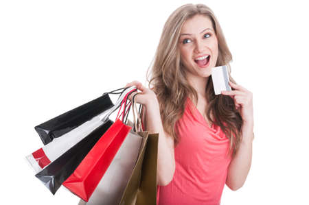 Shopping woman thinking what can she buy more using a credit or debit card photo