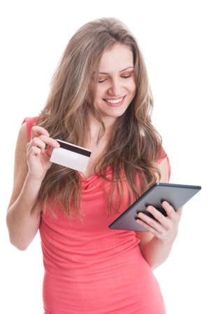 secured payment: Cute shopping girl holding a credit card while buying using a tablet Stock Photo