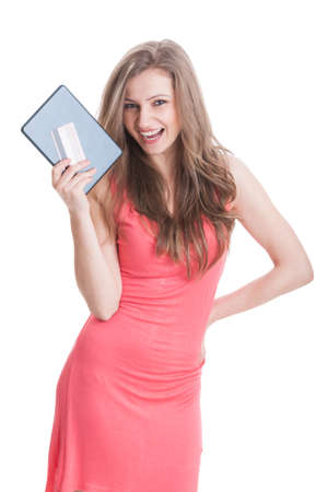 secured payment: Happy shopping girl holding tablet and card and wearing a pink summer dress on white background Stock Photo