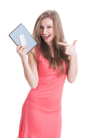 secured payment: Beautiful shopping girl holding tablet and card and wearing a pink summer dress on white background