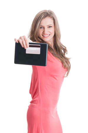 secured payment: Beautiful blonde lady showing a tablet and credit or debit card to the camera