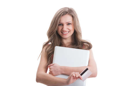 debit card: Beautiful young woman holding credit or debit card and laptop on white background