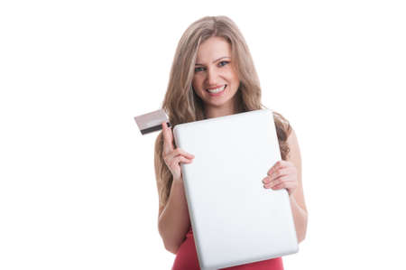 Girl holding closed laptop and a credit card on white background photo