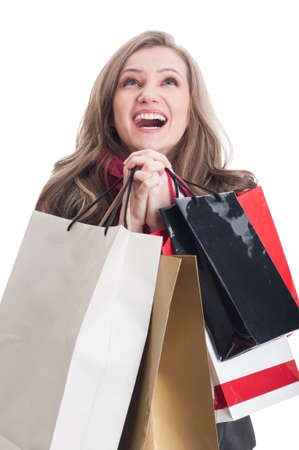Portrait of a beautiful and young shopping woman praying photo