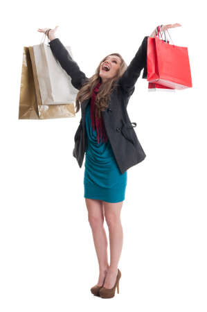 spending full: Shopping woman raising arms up in the air. Thrilled and cheerful shopping lady concept on white background