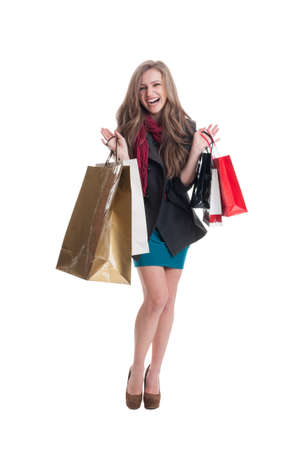 spending full: Excited shopping girl after she spent the money smiling isolated on white background Stock Photo