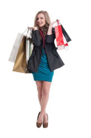 spending full: Shopping lady with beautiful smile holding shoping bags isolated on white background Stock Photo