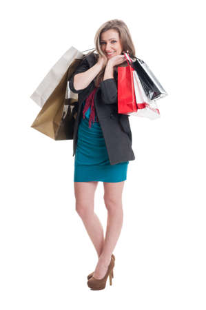 spending full: Cute and adorable shoping girl on white studio background Stock Photo