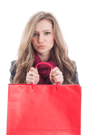 Cute and adorable female holding a red shopping bag isolated on white background photo