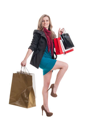 spending full: Shopping lady with beautiful legs on white background