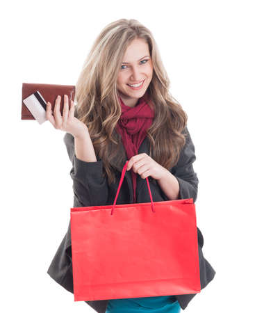debit card: Young and beautiful shopping lady holding credit or debit card, wallet and a red shopping paper bag Stock Photo