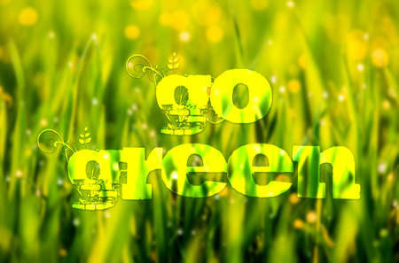 Go green concept text over green grass background photo