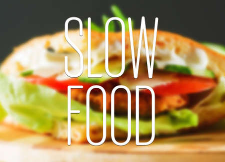 slow: Slow food concept text over healthy and natural ingredients sandwich Stock Photo