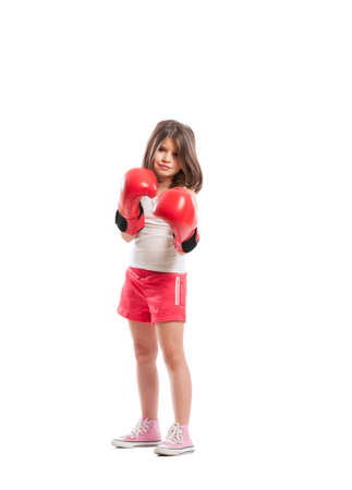 pugilist: Young boxer girl standing as a fighter on white  background Stock Photo