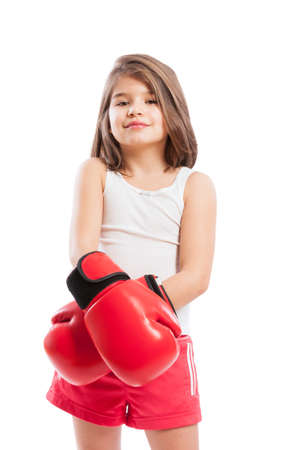 pugilist: Cute boxer child wearing red boxing gloves