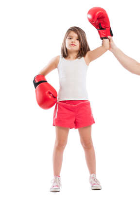 pugilist: Young boxer girl is a winner on white background Stock Photo