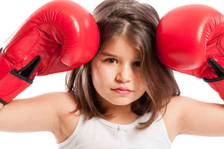 pugilist: Young boxer girl acting angry or mad and wearing red boxing gloves Stock Photo
