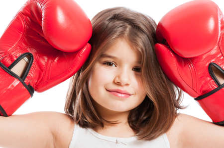 Closeup of a cute boxing girl wearing red box gloves photo