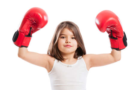 pugilist: Young boxer girl raising arms up and wearing red gloves