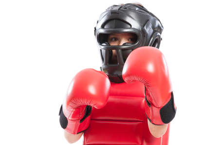 Portrait of a young boxer girl with full equipment on white background photo