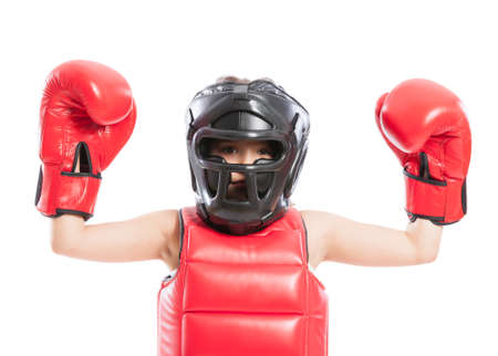 Adorable and young boxer girl wearing red boxing gloves and helmet photo
