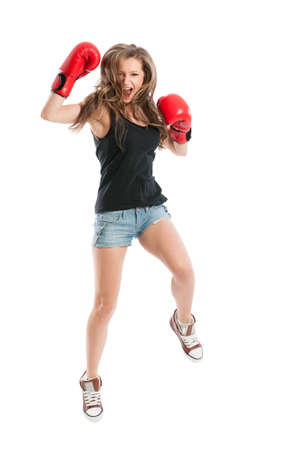 Young female model jumping and wearing red boxing gloves isolated on white background photo