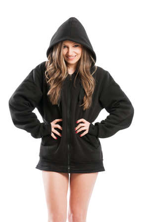 kinky: Sexy, cute, kinky and adorable young woman wearing a black hoodie standing isolated on white background