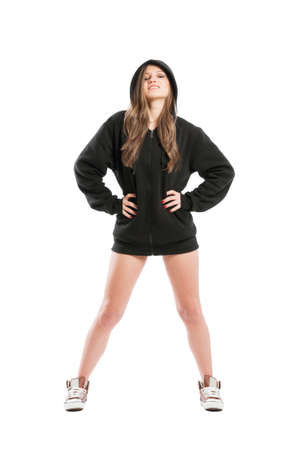 supercilious: Perky and sexy female wearing a black hoodie standing isolated on white background Stock Photo