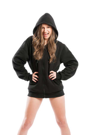 Kinky and sexy young woman wearing a black hoodie on white background photo