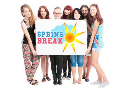 big break: Spring break text illustration concept wrote on big white card hold by teen girls