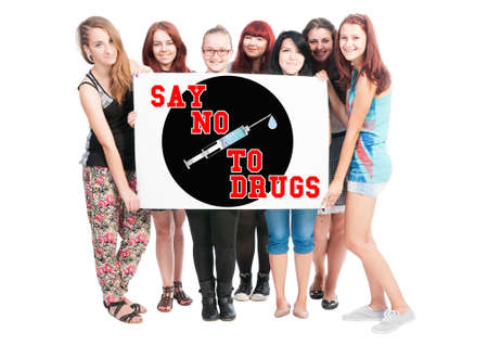 Say no to drugs text illustration concept wrote on big white card hold by teen girls