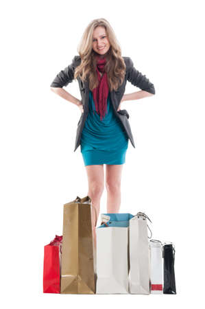 expressing: Shopping lady expressing confidence surrounded by shopping bags