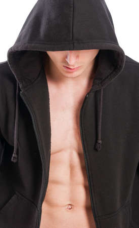 Closeup of male model torso with open hoodie showing six pack or perfect abs