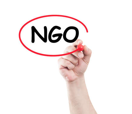 wipe: Hand circle ngo text on transparent wipe board with white background and copy space. Non governmental organization concept