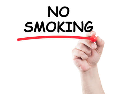 Hand writing no smoking underline text on transparent wipe board with white background and copy space photo